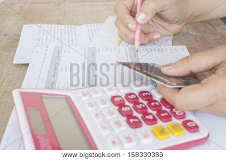 hand checking document monthly expense credit card
