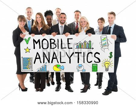Large Group Of Happy Businesspeople Holding Banner Of Mobile Analytic Concept On White Background