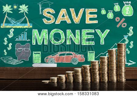Stack Of Coins In Front Of Blackboard Showing Save Money Concept