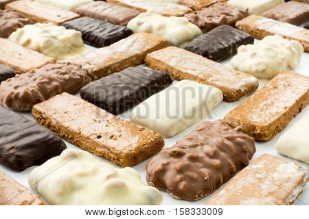 Closeup of an arrangement of assorted German Gingerbread Aachener Printen. Selective focus and shallow depth of field.