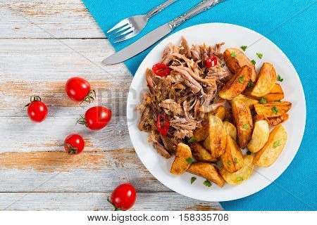 Fried Potato And Portion Of Pulled Slow-cooked Meat