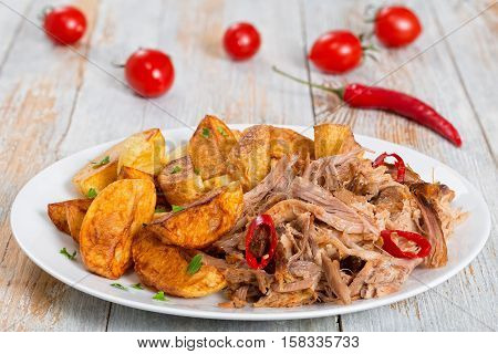 Pulled Slow-cooked Pork Shoulder With Fried Potato Wedges