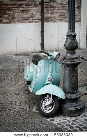 FANO ITALY - NOVEMBER 16 2014: The Vespa old italian scooter made by Piaggio parked on old street in Fano Italy.