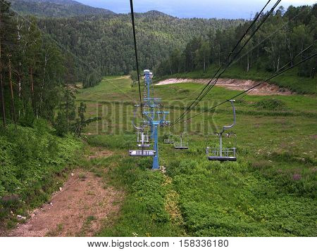 Old reliable chair lift. Summer. The mountains.