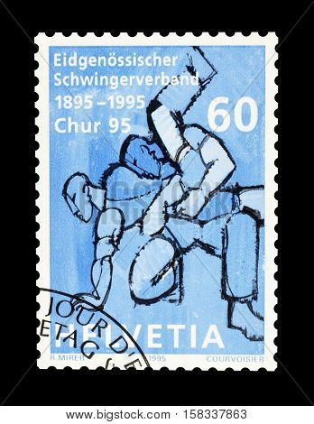 SWITZERLAND - CIRCA 1995 : Cancelled postage stamp printed by Switzerland, that shows Wrestling.