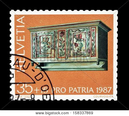 SWITZERLAND - CIRCA 1987 : Cancelled postage stamp printed by Switzerland, that shows Antique wall cupboard.