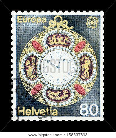 SWITZERLAND - CIRCA 1975 : Cancelled postage stamp printed by Switzerland, that shows Pocket watch.
