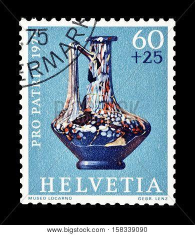 SWITZERLAND - CIRCA 1975 : Cancelled postage stamp printed by Switzerland, that shows Henkel glass jar.