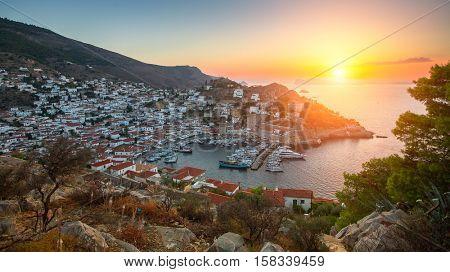 Panoramic views of the marina at Hydra island during sunset Aegean sea, Greece.