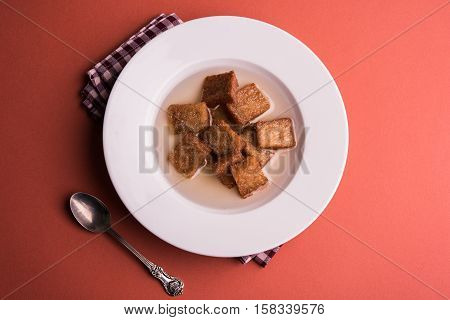 Caramelized sweet Toast or meetha or meethe toast dipped in sweet syrup or bread gulab jamun is a popular sweet dish, also known as shahi Tukda, selective focus poster
