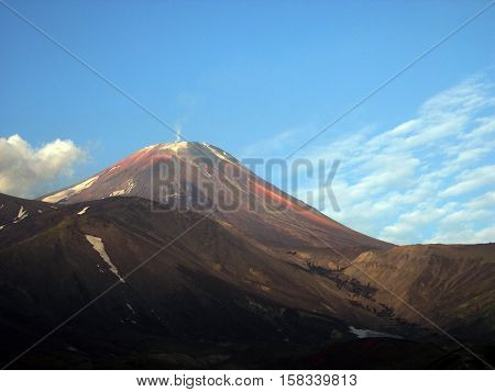 Kamchatka peninsula, the landscape. Early morning and the blue sky, the volcano. Kamchatka, Far East, Russia