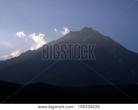 Sunrise. Kamchatka Peninsula, landscape. Early in the morning, blue sky, volcano. Kamchatka, Far East. Russia