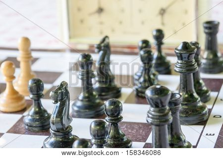 Chessmen And Hours On A Board