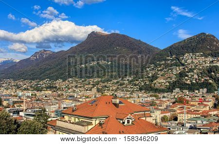 View on the city of Lugano in Switzerland, mountains Monte Boglia and Monte Bre in the background. Lugano is the largest city of the Swiss canton of Ticino.