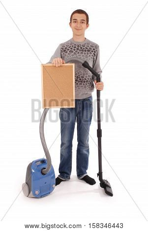 Boy holding a frame with a vacuum cleaner isolated on white background