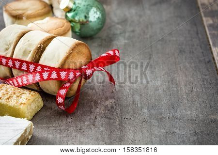 Variety of Christmas sweets on wooden background