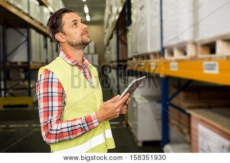 Man in a warehouse in checking inventory levels of goods. First in first out Last in last out concept photo