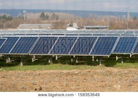 Sun electricity collectors near the city fields