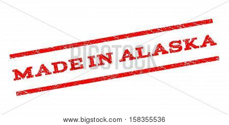 Made In Alaska watermark stamp. Text tag between parallel lines with grunge design style. Rubber seal stamp with dust texture. Vector red color ink imprint on a white background.