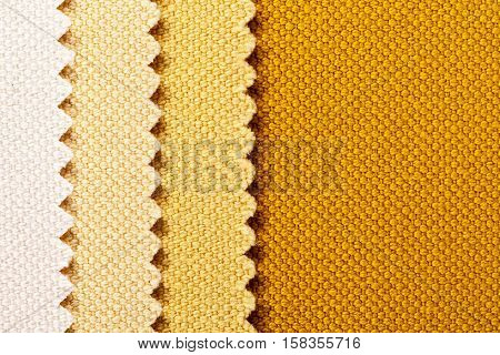 Composition of colored vertical stripes of serrated cotton fabric place for text