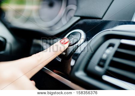 Woman Starts The Car Engine With Start-stop Button