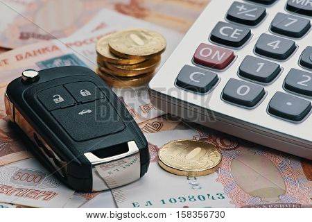 Russian Money, Calculator And Key From Car.