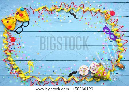Colorful carnival background with party accessory, streamers, confetti, ribbon, doughnuts and champagne glasses