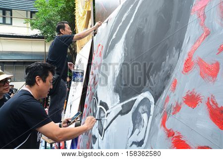 BANGKOK THAILAND - November 122016 : Thai art students paint portraits of Thai King Bhumibol Adulyadej at Silpakorn University in Bangkok. King Bhumibol the world's longest reigning monarch.
