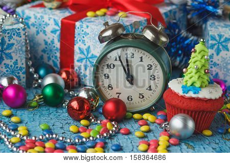 Christmas Clock And Cupcake With Colored Decorations