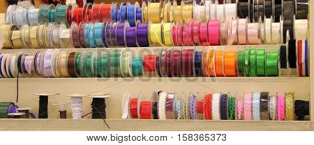 Rolls of Coloured Ribbon For Sale on a Market Stall.