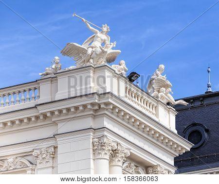 Zurich, Switzerland - 25 May, 2016: upper part of the Zurich Opera House building. Zurich Opera House has been the home of the Zurich Opera since 1891, it also houses the Bernhard-Theater Zurich and the Zurich Ballet.