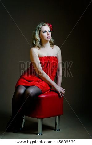 Woman Sitting On Banquette