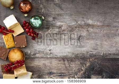Christmas nougat and spanish polvorones on wooden background. Copyspace
