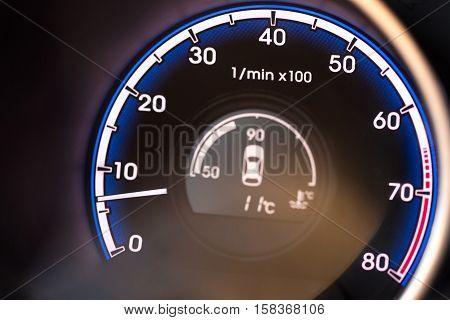 Close up of a Tachometer in a Car