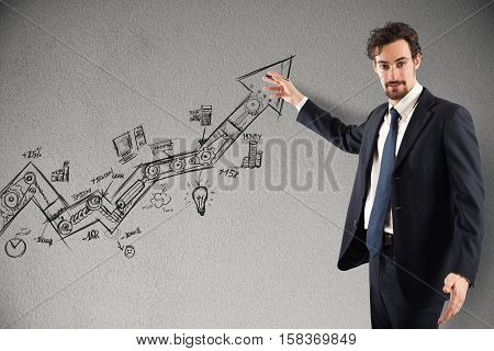 Businessman draws and shows graphics on an arrow uphill