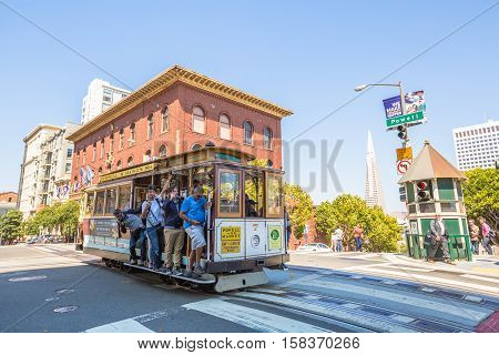 San Francisco, California, United States - August 17, 2016: a Cable Car ride for California and Powell streets, where the three lines intersect in a set double crossovers.