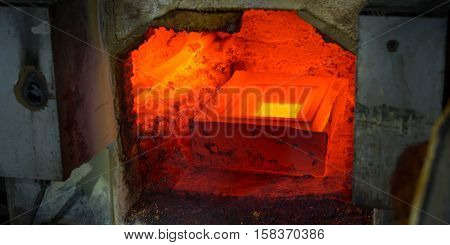molting gold in a stove at a factory