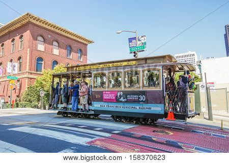 San Francisco, California, United States - August 17, 2016: a Cable Car Powell-Mason Line, cross to California and Powell streets near University Club of San Francisco.