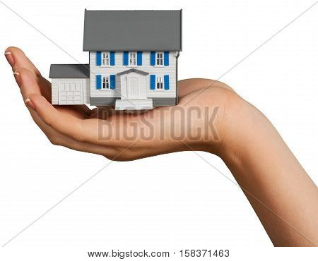 Woman's Hand Holding a Modef of House - Isolated