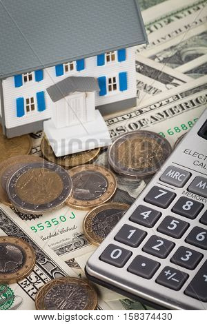 Model of a House and Calculator on Money - Close Up