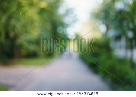 bokeh blur background of small street in town summer time photo