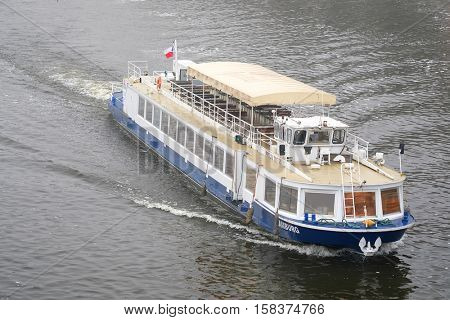 Prague, Czechia - November, 21, 2016: boat on Vltara river in Prague, Czechia