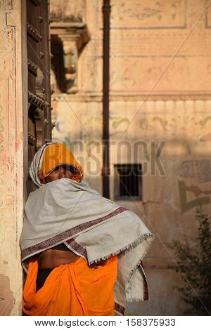 MANDAWA, RAJASTHAN, INDIA - FEBRUARY 14, 2016 - Unidentified indian woman with colorful dress inside an old traditional haveli