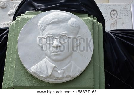 BANGKOK THAILAND - November 162016: plaster Bas relief of His Majesty King Bhumibol portrait at the wall in front of the Pohchang Academy Of Arts to art exposition in Bangkok Thailand.