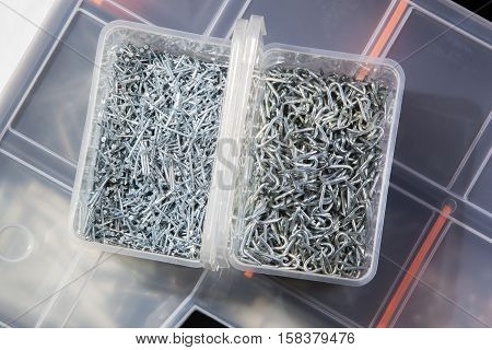 Close-up of nails in a box on a toolbox