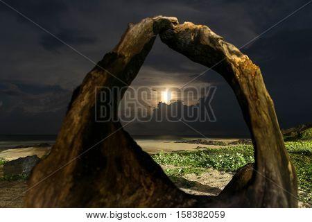 Full moon rising over the Samila beach Songkhla province Thailand