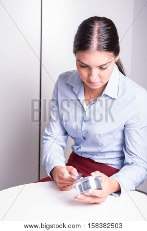 Young employee works at the quality control