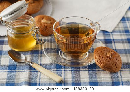 Tea Cup With Oatmeal Cookie On Dark Wooden Table Covert Tablecloth