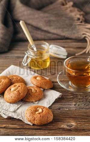 Cup Of Tea With Oatmeal Cookie On Dark Wooden Table Covert Tablecloth