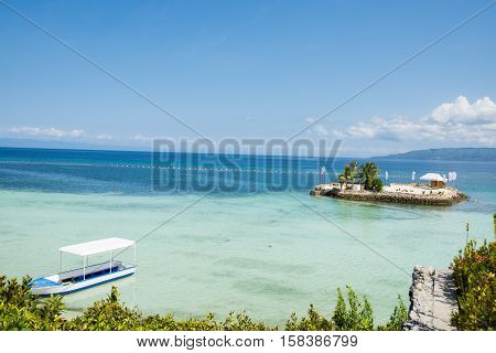 a small island across the beach to open sea at Panglao Island Nature Resort, Bohol